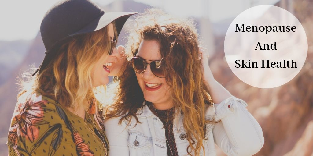 2 women with sunglasses laughing